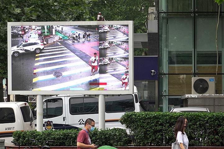 Beijing District Turns to Smart Tech to Upbraid Pedestrians Who Run Red Lights