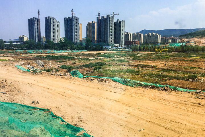 Beijing Sells Land for Quarter Over Asking Price as City Scraps Price Cap
