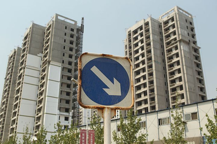 Buy a House, Get a BMW: Tighter Rules Push China's Property Developers to Seek Quick Sales