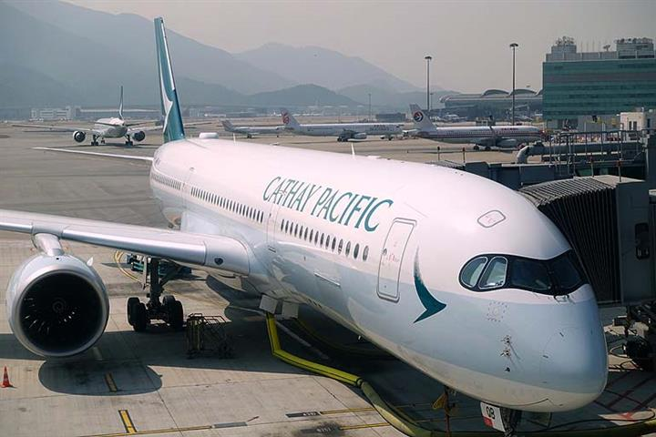 Cathay Pacific, Swire Pacific, Air China Suspend Trading in Hong Kong