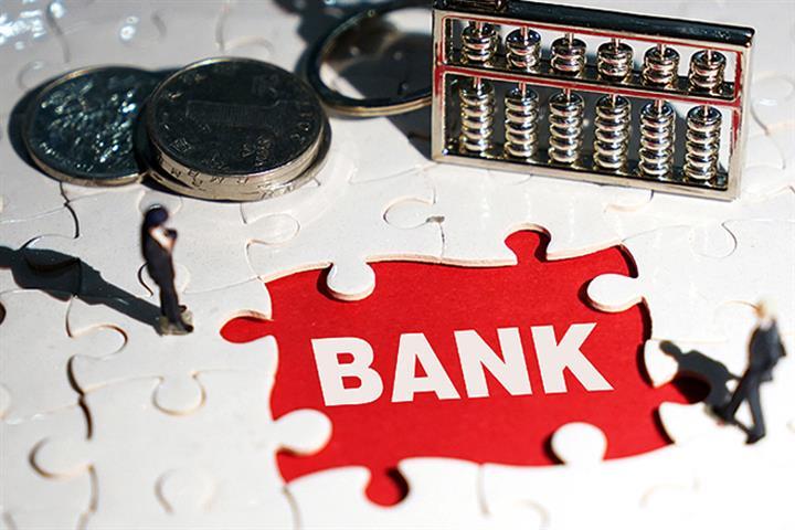 China's Banks to Write Off USD489 Billion of Bad Debt This Year, Regulator Says