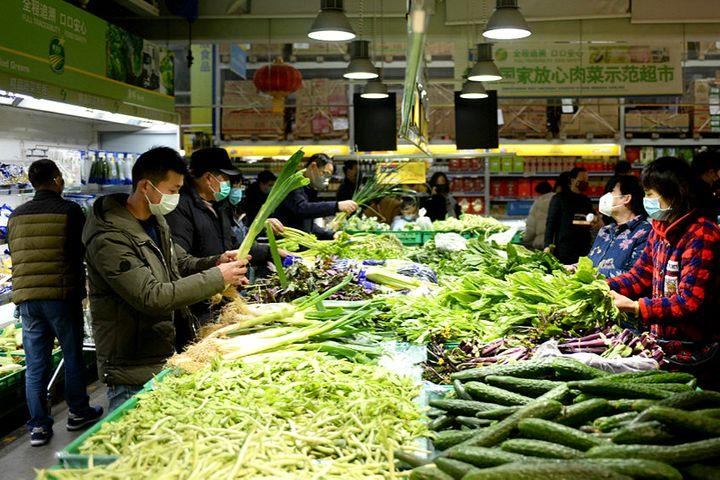 China's Consumer Inflation Cooled in March as Food Prices Fell