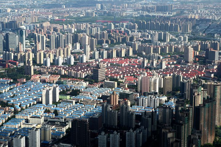 China's Home Prices Edged Up in March as Financing Got Easier, CASS Says