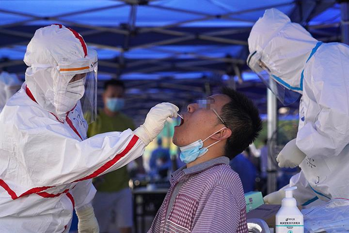 China Slashes Cost of Covid-19 Tests Ahead of Lunar New Year Holiday