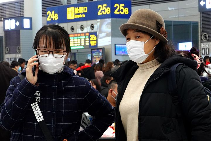 Facial Masks Sell Out in China as New Virus Spreads