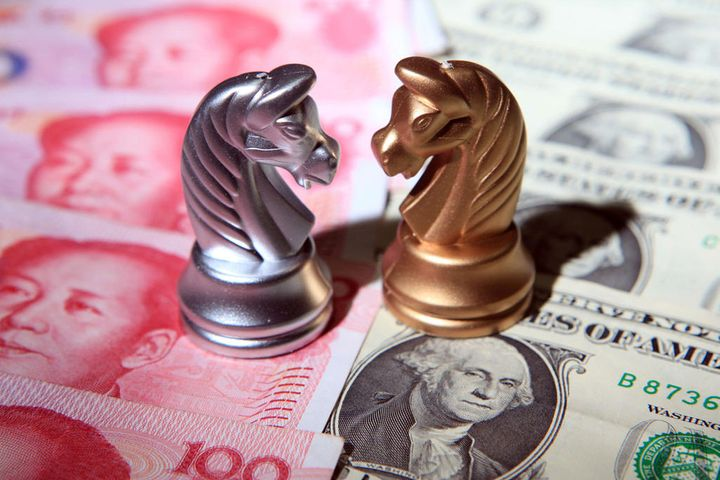 Fed Coos Dovishly as Yuan Rallies to Nine-Month High Against Dollar