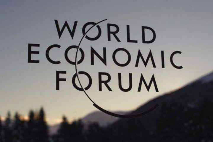 Last Week's News in Photos: Davos, Gene-Edited Monkeys, 5G Gadgets