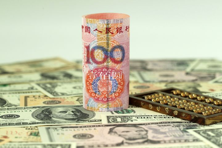 PBOC Cuts Yuan-Dollar Central Parity Rate by 85 Basis Points