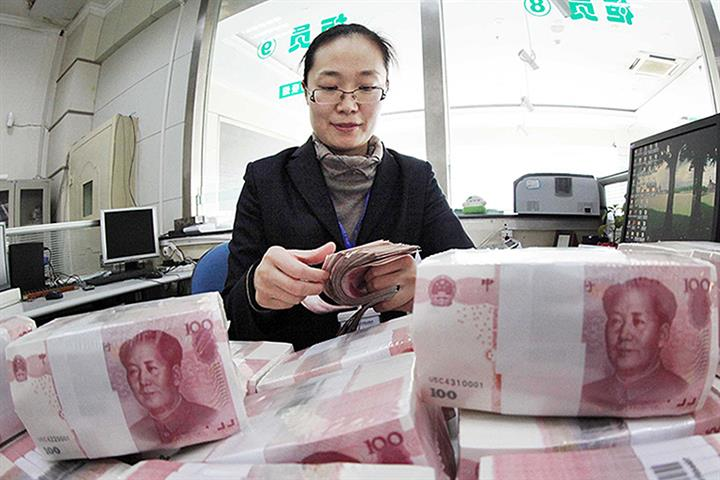 Shanghai Can Take Further Step in Yuan Convertibility, PBOC Governor Says