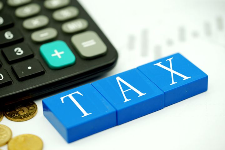 Tax Burden on Chinese Producers Eased 0.34 Points Last Year, Official Says