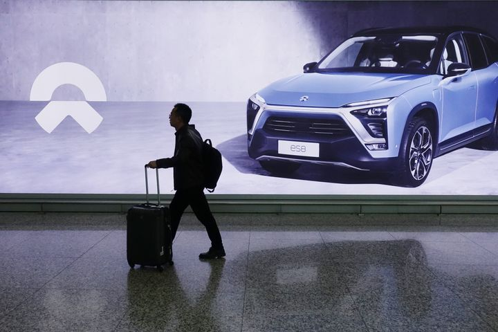 Tencent-Backed Tesla Rival Forms NEV Ride-Hailing Firm