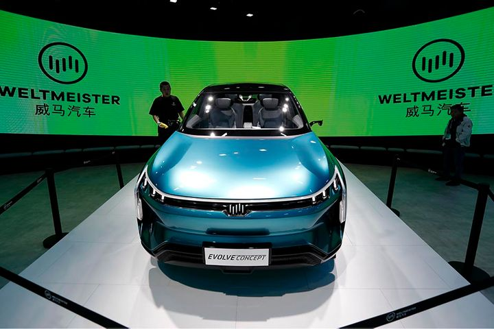 China's WM Motor Is Said to Seek Easier IPO Route via Ownership Change
