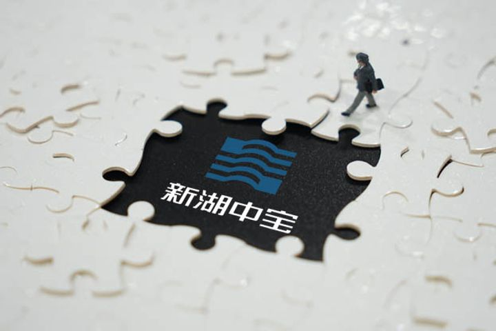 Xinhu Zhongbao Wins 6% Stake in Financial Service Supplier Wind Information